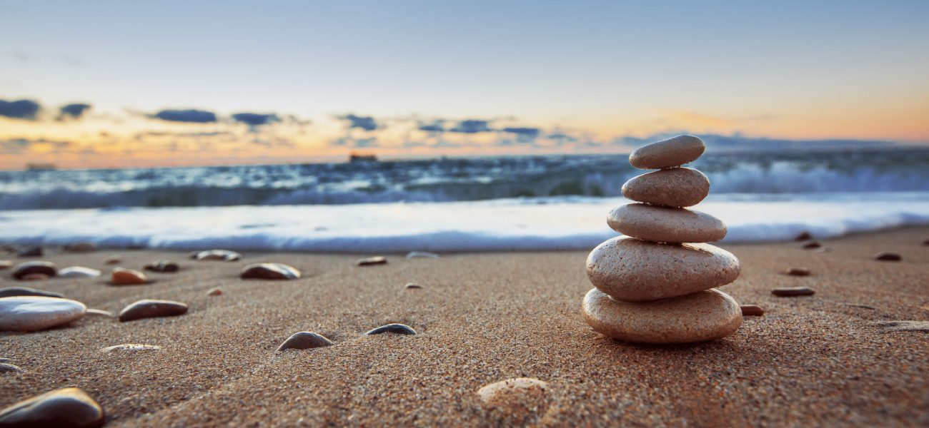 25114848 - stones balance on beach, sunrise shot